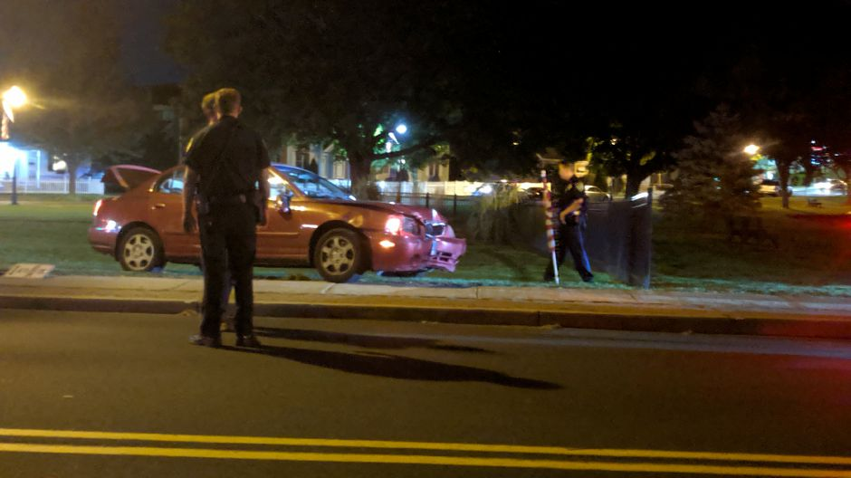 Wallingford – Police direct a tow truck driver to remove a sedan that was driven off the road and into a lamp post Tuesday night. Police have charged a 29-year-old Meriden women, who they say was driving under the influence of alcohol when the crash occurred. /Michael Gagne, Record-Journal