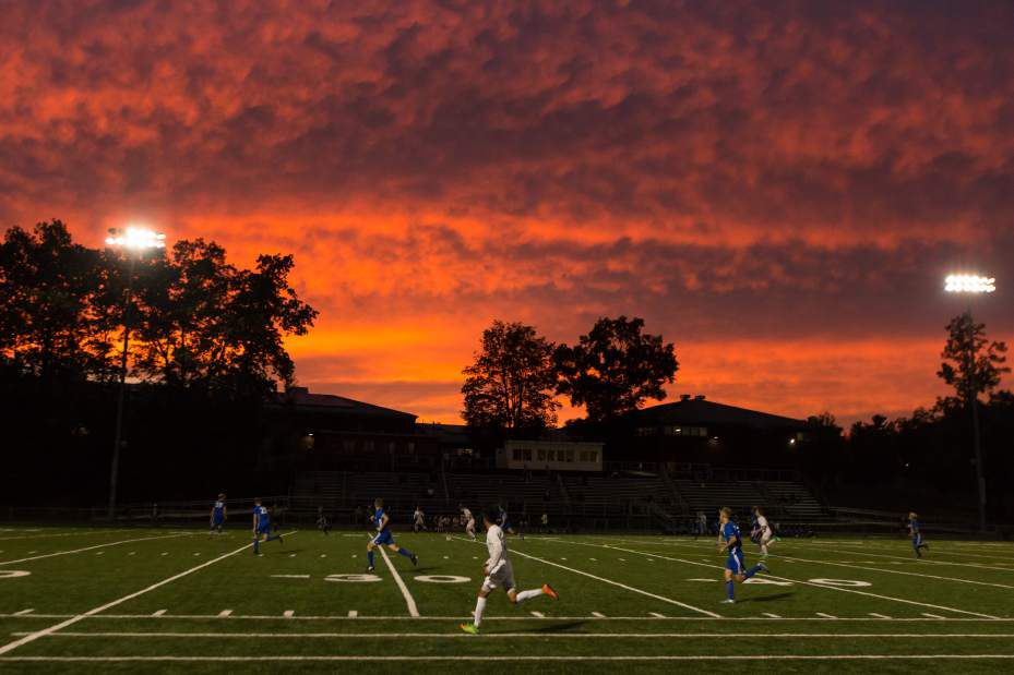 Against the backdrop of a stunning sunset, Maloney boys soccer took the field against Plainville Thursday at Falcon Field. | Justin Weekes / For the Record-Journal