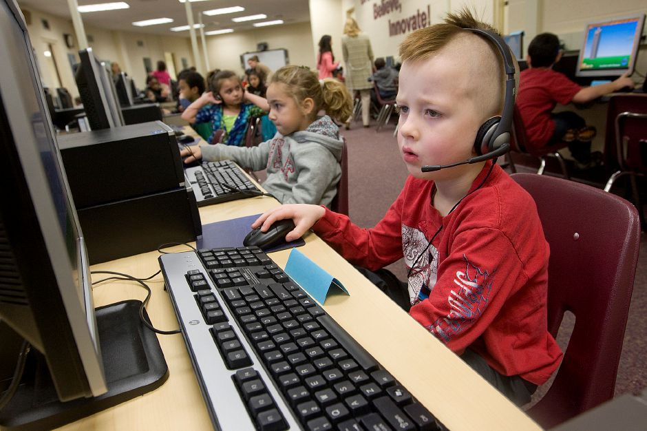 "FILE PHOTO: First grade student Thomas Rolfe works in the computer lab during the extended day program at Casimir Pulaski School in Meriden, November 14, 2012. The school district is struggling to sustain its extended day programs but has maintained a ""college culture"" even in younger grades. (Dave Zajac/Record-Journal)"