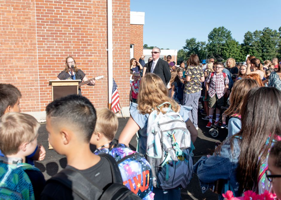 Wheeler Elementary School music teacher Veronica Brendel played a few songs before the start of school in Plainville on Sept. 3, 2019. | Devin Leith-Yessian/Plainville Citizen
