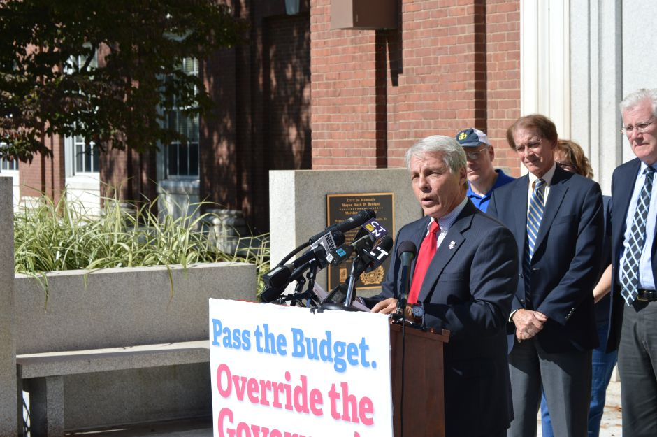 Sen. Len Suzio, R-Meriden, and Wallingford Mayor William W. Dickinson Jr., behind Suzio, spoke in support of the Republican budget at a Monday press conference in front of Meriden City Hall. | Mike Savino, Record-Journal