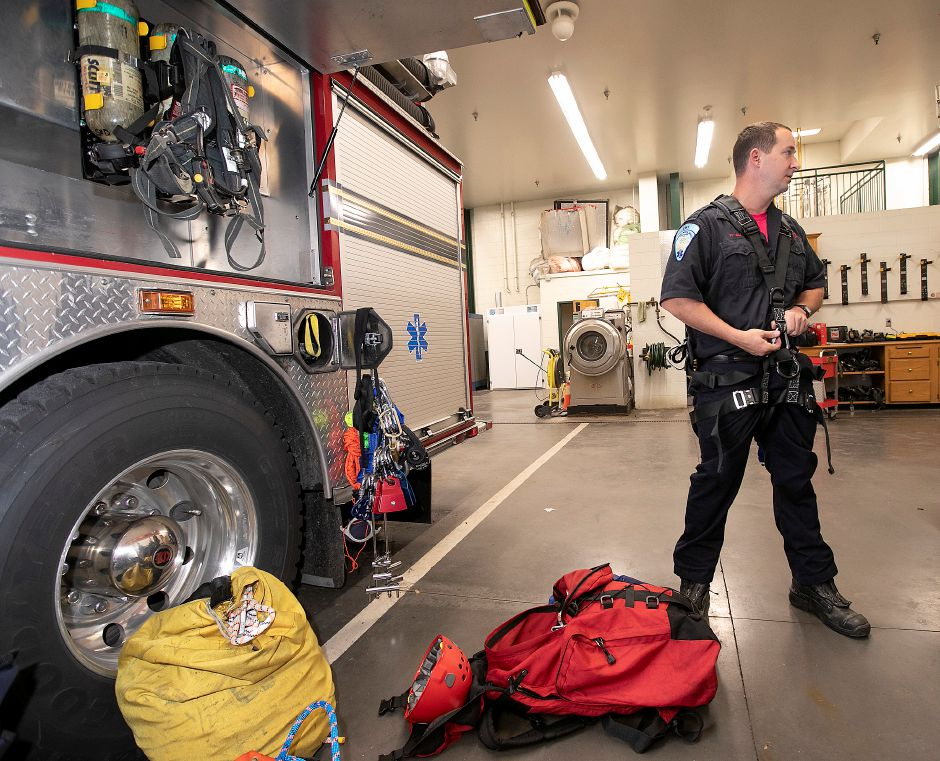 Firefighter Kevin Guy wears rope rescue gear supplied on Squad 1 at Southington Fire Headquarters, Fri., Oct. 18, 2019. Dave Zajac, Record-Journal
