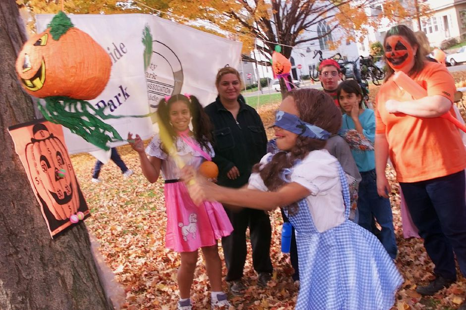 "Michelle Montgomery, 8, dressed as ""Dorothy"" from the Wizzard of Oz, tries her hand a breaking the pumpkin-shaped pinata at the Halloween party at City Park Sat., Oct. 30 1999 put on by the City Park/Brooksibe Park Neighborhood Association."