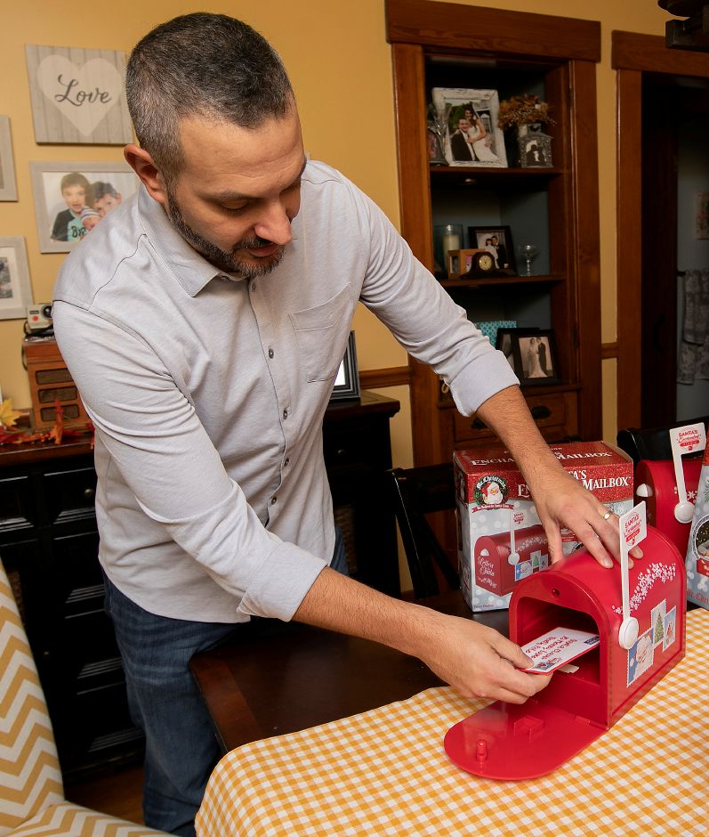 "Chris Cirri, of Wallingford, demonstrates his ""Santa's Enchanted Mailbox"" on Thursday. Letters to Santa ""magically"" disappear to the North Pole. Letters can also reappear in the mailbox. The product is  available on Amazon and at WalMart, Home Depot, Lowes and many other stores. It is also available in select shops in Australia and QVC in the United Kingdom."