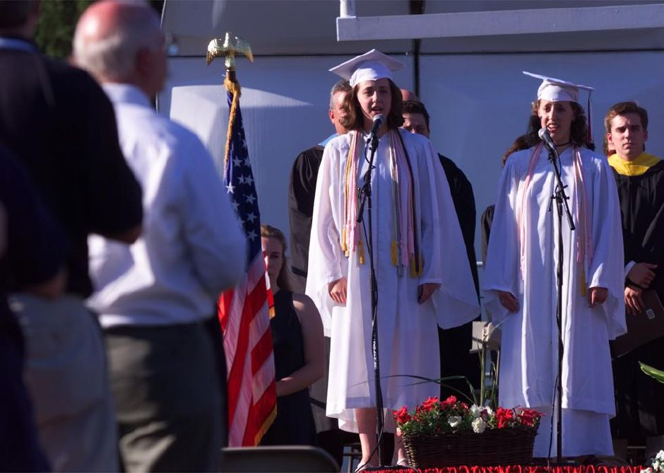 "RJ file photo - Two members of the senior VIPs, a singing group, Michelle Adessa, left, and Amy Helfer sing ""The Star Spangled Banner,"" to start off the Cheshire High School commencement exercises Monday night June 21, 1999."
