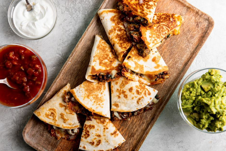 This image shows a recipe for cheesy ground beef quesadillas. More people are cooking at home these days, and when they do eat restaurant food, they're often looking for comfort food, experts say. Other trends include simpler recipes, recipes with fewer ingredients, one-pot meals, sheet-pan meals, finger food and pantry-ingredient recipes, all up significantly year over year. (Cheyenne M. Cohen/Katie Workman via AP)