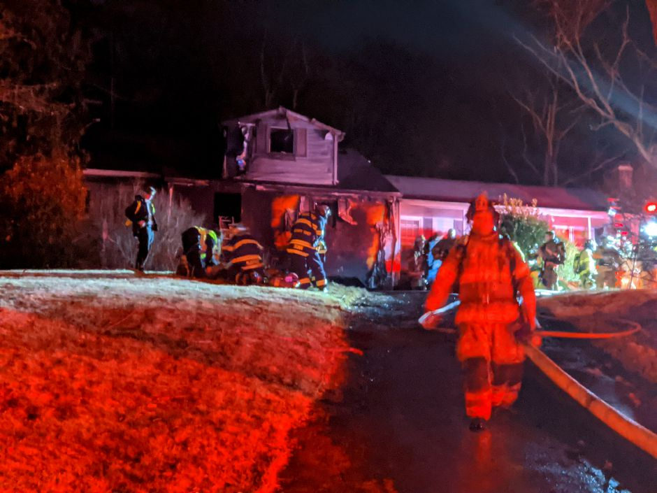 Firefighters extinguished a reported garage fire at 72 Northford Road Friday night. A resident of the home suffered significant burns in the fire. Michael Gagne, Record-Journal