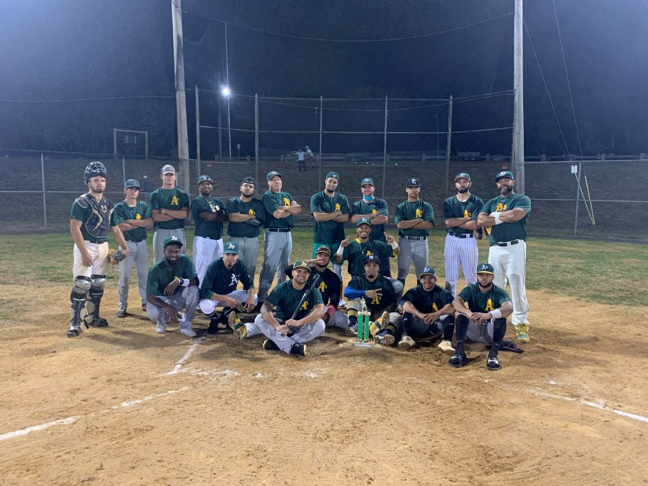 The Downtown Merchants went 8-0 to win the 2020 regular season and playoff crowns in the Wallingford Twilight Baseball League. Team members, top row, left to right, are Tyler Ekstrom, Aidan Weir, Kyle Simmons, Carlos Ozoria, Rey Duprey, Dave Destefano, Jaimito Lebron, Kevin Weir, C.J. Vasquez, Devyn McCarty and Jose Caballero. Bottom, left to right, are Jorge Guzman, Brayan Aguilera, Cesar Gutierrez, Cesar Carrasco, Jensey Padilla, Peter Abate and Luis Crucetax. Kneeling in the middle is Jesus Garcia. Photo courtesy Kevin Weir
