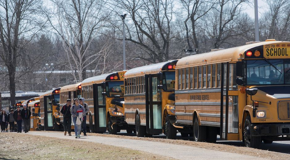 Lyman Hall High School students head to their buses at dismissal, Monday afternoon, Monday, March 26, 2018. Dave Zajac, Record-Journal