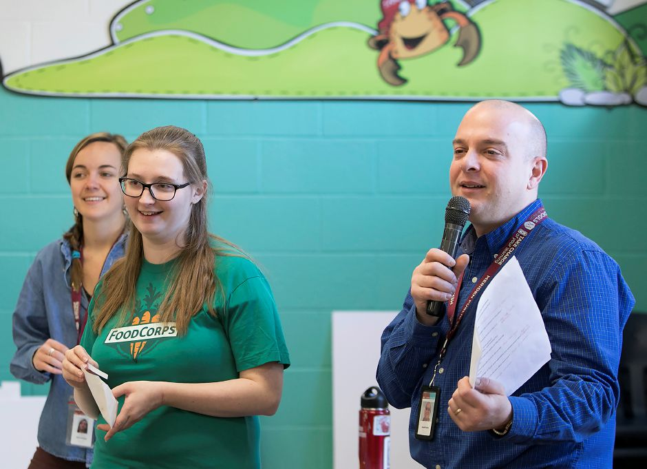 Music teacher, Don Horton, asks students trivia questions next to FoodCorps members Jaime Traverse, far left, and Tara Mahoney during lunch break at Israel Putnam Elementary School in Meriden, Thursday, Feb. 8, 2018. Dave Zajac, Record-Journal