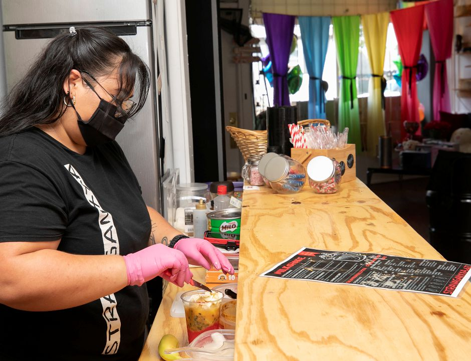 Angiee Betancourt, owner of Stravaganxxa, prepares a Cholado at the 182 Quinnipiac St. business in Wallingford, Tues., Aug. 25, 2020. The Cholado is made with strawberry syrup, passionfruit, soursop, mango, pineapple, banana, strawberry jam, condensed milk, milo and ice. Dave Zajac, Record-Journal