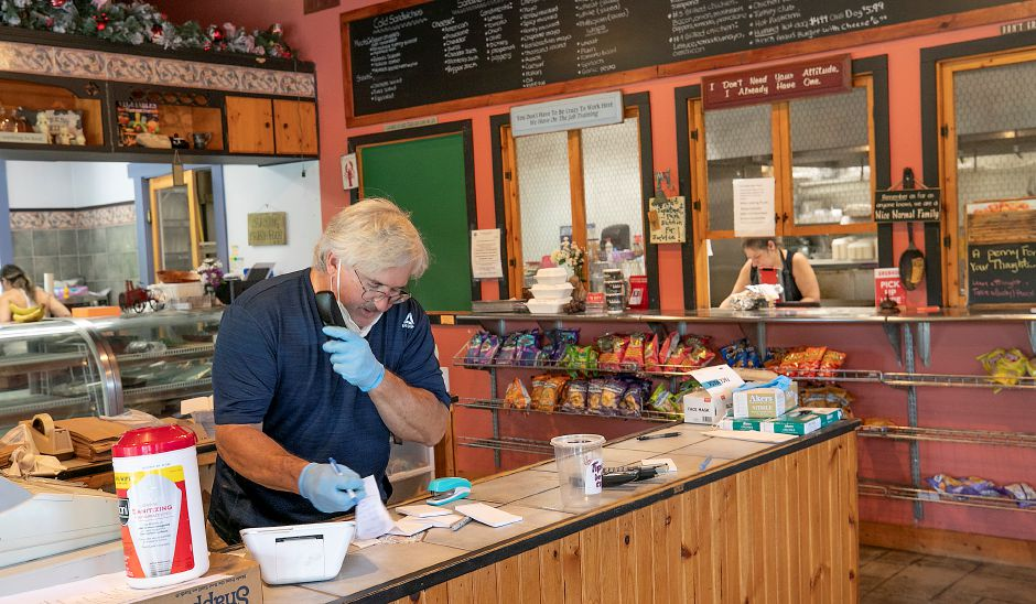 Russell Bandecchi, owner of the Spoonshoppe Brooke Deli, takes an order.
