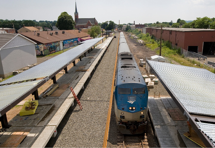 An Amtrak train passes under the Wallingford train station being constructed off North Cherry Street, Wednesday, July 6, 2016.  | Dave Zajac, Record-Journal