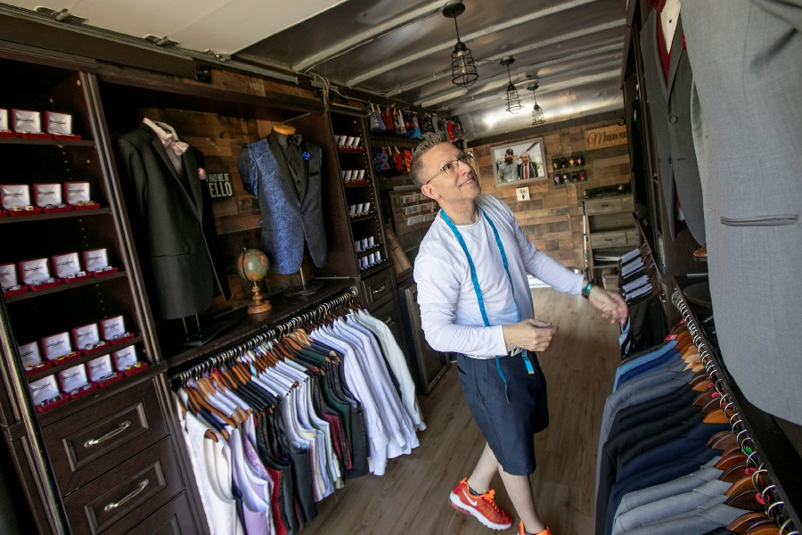 John Dominello, owner of Modern Formals, looks over a variety of tuxedos and accessories available in his mobile showroom parked in front of the 474 North Main St. business in Southington on Tuesday. Photos by Dave Zajac, Record-Journal