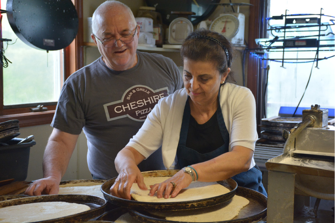 Minas and Hope Halkias, of Cheshire Pizza, prepare for the early lunch rush on Friday | Ariana D'Avanzo / For the Record-Journal
