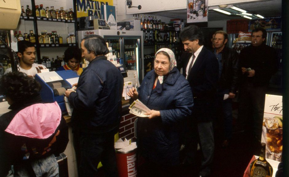 RJ file photo - Connecticut Lotto players stand in line to buy tickets at the Brown Jug on East Main Street in Meriden, Jan. 1990.