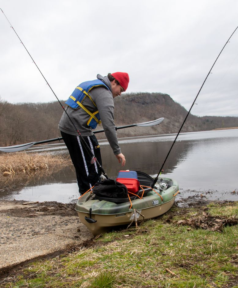 Thomas Leffingwell of Wallingford hit Black Pond via kayak to fish for trout. The 2020 trout season was opened several weeks early by Gov. Ned Lamont. | Aaron Flaum, Record-Journal