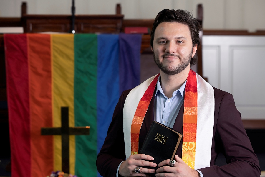 Pastor Connor Filkins, of Wallingford, stands in the sanctuary of Center Congregational Church, 474 Broad St., Meriden, Thurs., Jul. 9, 2020. Filkins took over as pastor in May. Dave Zajac, Record-Journal