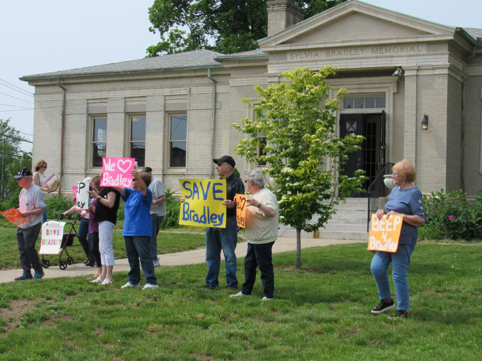 Members of the Community Committee to Save Bradley rally in front of the Southington Historical Society, Saturday, June. 1, 2019. | Jeniece Roman, Record-Journal.