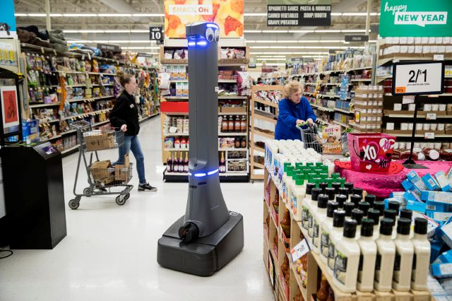 A robot named Marty cleans the floors at a Giant grocery story in Harrisburg, Pa., Tuesday, Jan. 15, 2019. On Monday, the Carlisle-based Giant Food Stores announced new robotic assistants will be arriving at all 172 Giant stores by the middle of this year. The chain