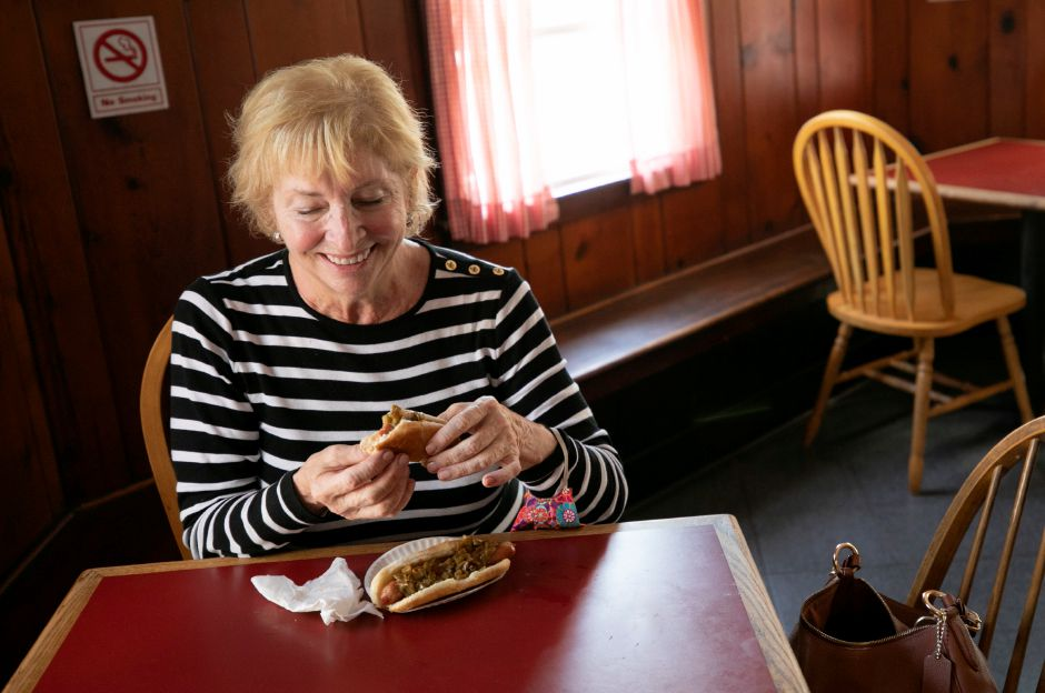 Lifelong customer Mary Helen Levine, of Waterbury, enjoys two hot dogs with relish and mustard during lunch at Blackie
