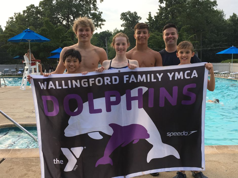 From left: Neil Alejandro, Joey Zellner, Elise Richardson, Adam DiDomenico, coach Matt Berry and Andrew Furtado pose for a photo during a practice in Wallingford on Tuesday. The five swimmers will be participating in national competitions this month.