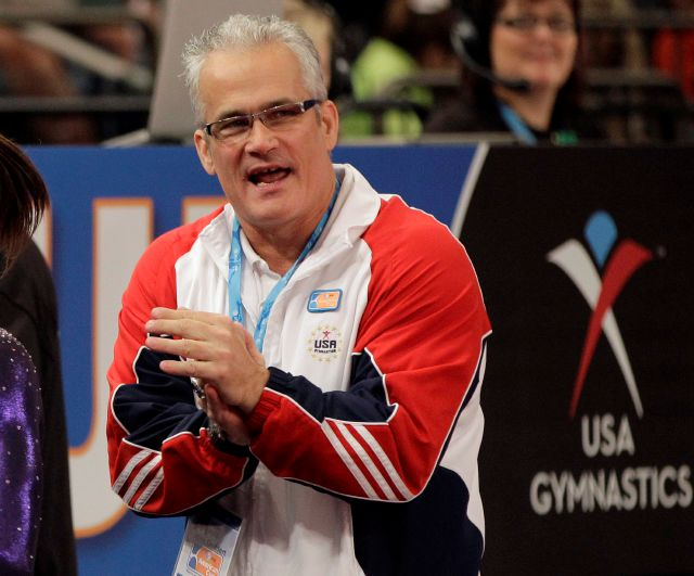 FILE - In this March 3, 2012, file photo, gymnastics coach John Geddert is seen at the American Cup gymnastics meet at Madison Square Garden in New York. Prosecutors in Michigan filed charges Thursday, Feb. 25, 2021, against Geddert, a former U.S. Olympics gymnastics coach with ties to disgraced sports doctor Larry Nassar. Geddert was head coach of the 2012 U.S. women