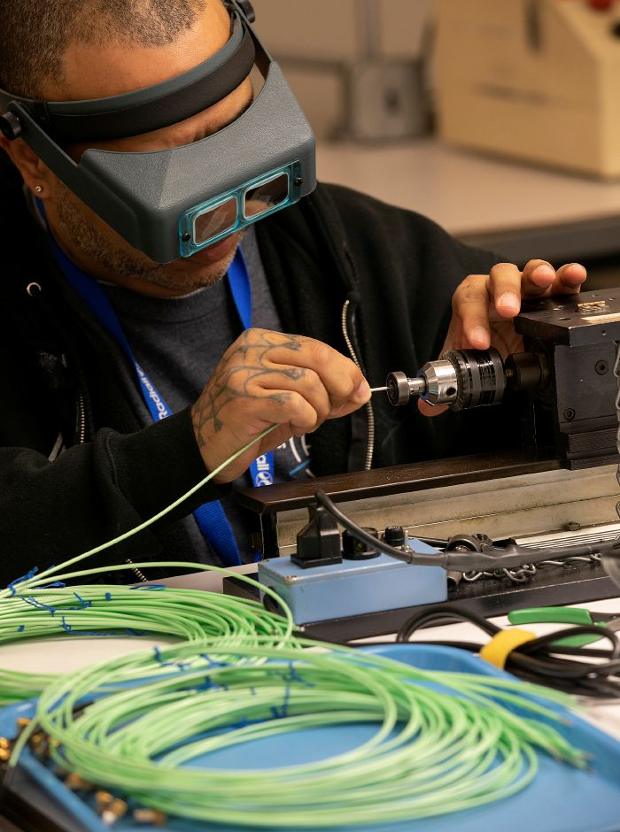 Erasto Lugo, assembler, prepares connectors for soldering at Radiall in Wallingford, Tues., Dec. 10, 2019. Radiall has relocated its design and assembly operation from New Haven to space vacated by Webster Bank at 777 Northrop Rd. Dave Zajac, Record-Journal