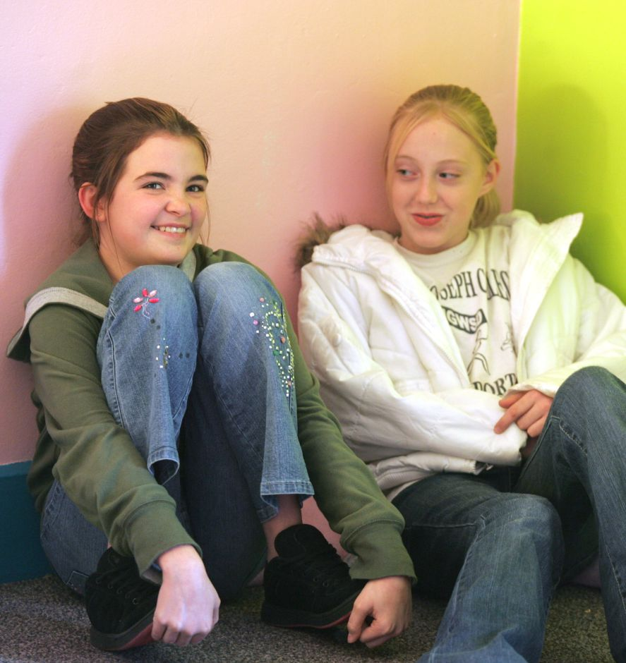 Amy Gagne, left, and Jocelyn Loomis, both 12 from Washington Middle School in Meriden, talk about journals, Jan. 2007. This is at Girls Inc. on Lincoln Street in Meriden where girls in the junior leadership program are keeping writing journals and were inspired by the movie