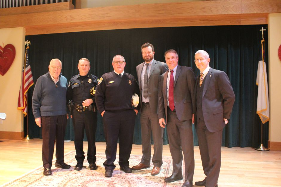 From left,  Elim Park Chaplain Wayne Detzler, Cheshire Police Chief Neil Dryfe,  Fire Chief Jack Casner,  Town Manager Sean Kimball, Elim Park CEO and President Brian Bedard, and Elim Park CFO Zell Gaston all attended the check presentation on Feb. 13 at Elim Park.
