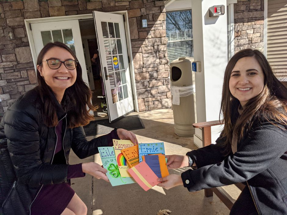 Quinnipiac University graduate students Michelle Zubko, left, and Julia Kowal, right, show off gratitude cards they