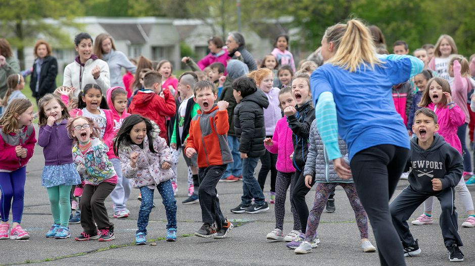 Derynoski Elementary School students give out a shout while following the lead of Zumba instructor Alyson Grisham during Activate Southington
