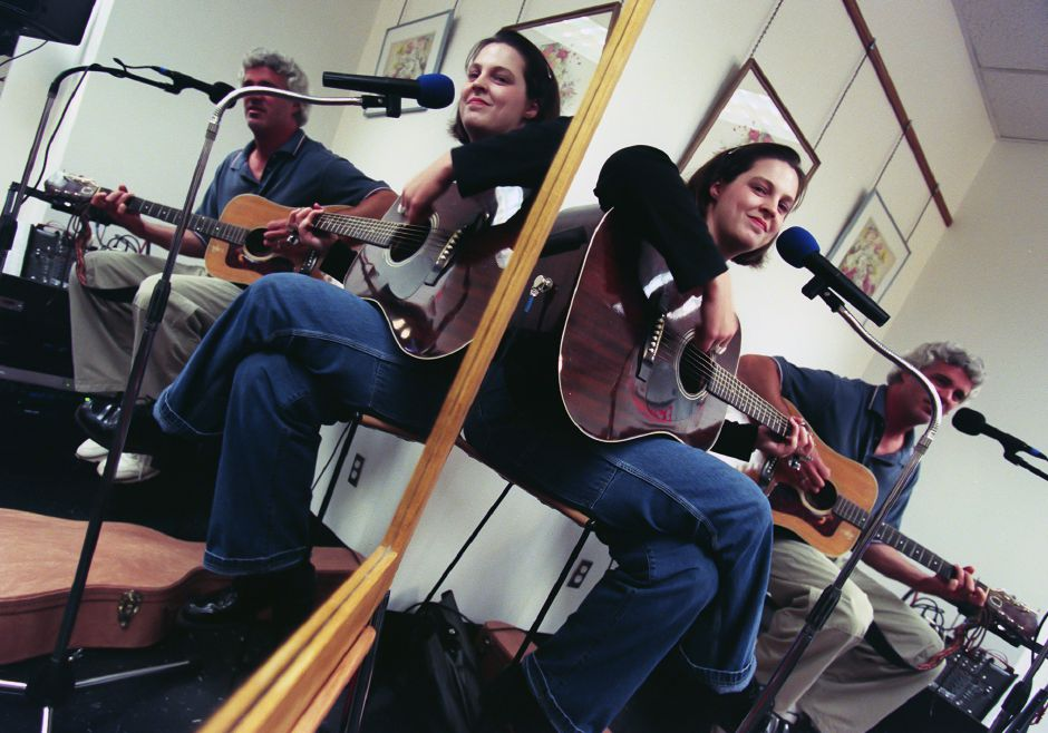 Reflected in a mirror, Kat Roberts and her dad Rooney Roberts of Meriden play an acoustic set of Kat