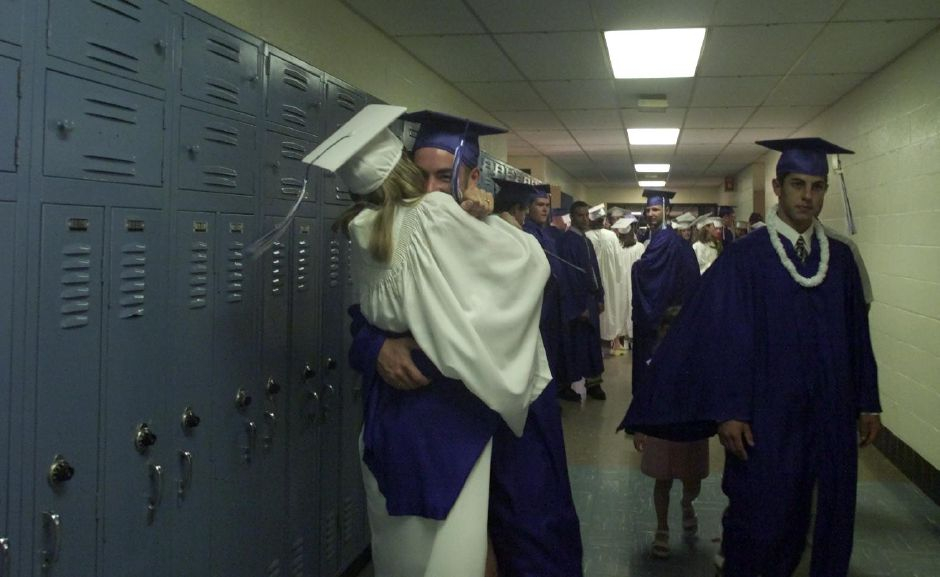 Kelly Cosgrove and Nick Barbato hug behore they line up for graduation at Lyman Hall High School Tuesday night at Lyman Hall in Wallingford June 20, 2000.