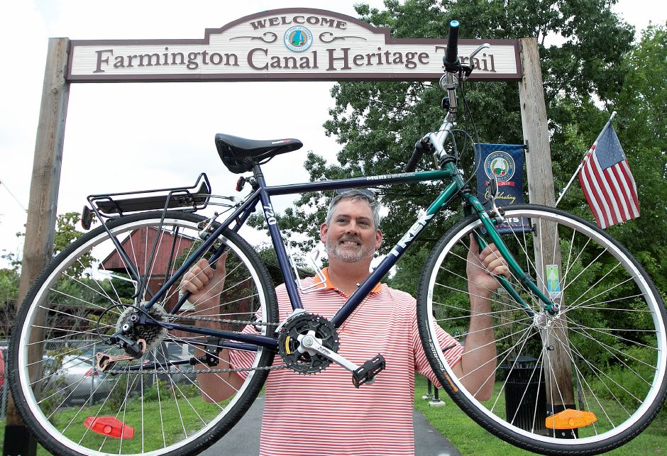 Jim Jinks, executive director of Bike Cheshire, holds one of several bikes available for rental from Pop