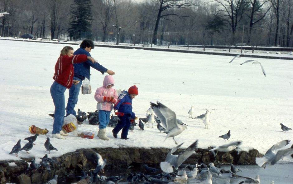 RJ file photo - Debbie Mulonet and her brother Joe Cote enjoy a Tuesday outing in Meriden, feeding the ducks at Hubbard Park with Mulonet