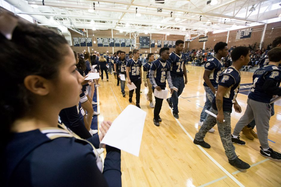 Angie Velez cheers the football team as they enter the gym Wednesday during the Platt Pep Rally at Platt High School in Meriden November 22, 2017 | Justin Weekes / For the Record-Journal