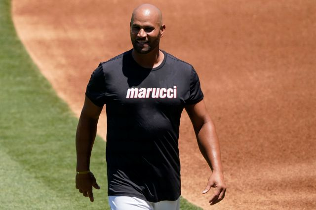 Los Angeles Angels first baseman Albert Pujols smiles during baseball practice at Angels Stadium, Monday, July 6, 2020, in Anaheim, Calif. (AP Photo/Ashley Landis)