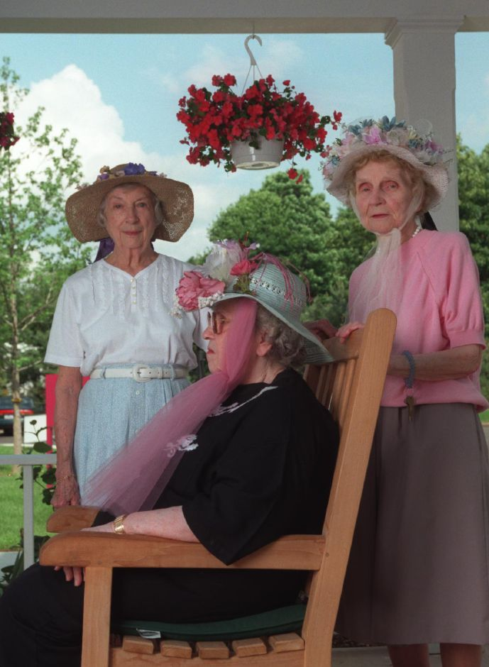 Juanita Goldstrohm, left, Jean Rakowski, right, and Adele Lulevitch, sitting, will wear these Victorian style hats that they made to the Barnes Museum