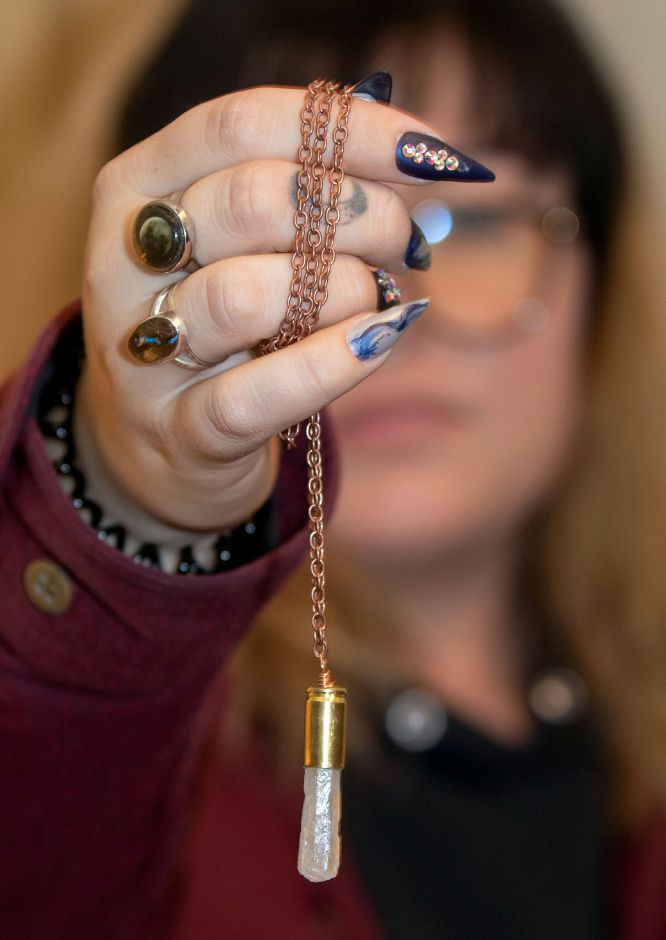 Alyssa Martin, of Wallingford, holds one of her bullet casing necklaces on Thursday, Jan 21, 2021. She sells the items online. Visit her site at https://www.etsy.com/shop/BITETHEBULLETGEMS Aaron Flaum, Record-Journal