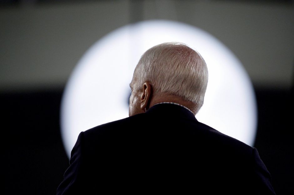 Republican presidential candidate Sen. John McCain, R-Ariz., is silhouette by a light as he speaks at a rally at Cabarrus Arena & Event Center in Concord, N.C., Saturday, Oct. 18, 2008. (AP Photo/Carolyn Kaster)