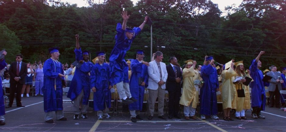 Joseph Bryans, of the Carpentry class, jumps into the air after the end of graduation at Wilcox Tech Fri., June 18, 1999.