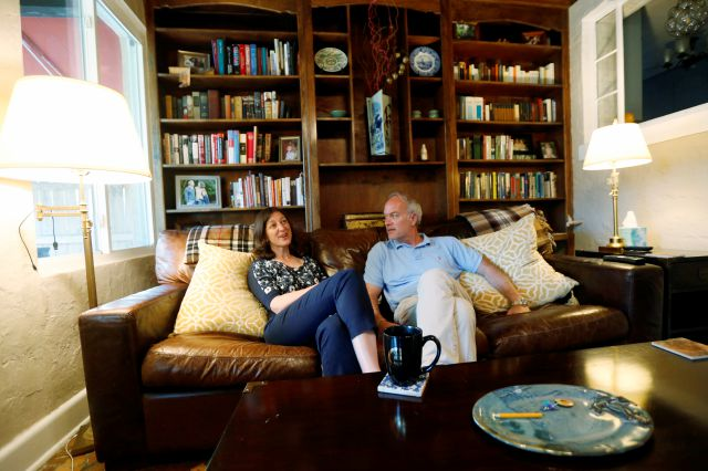 Rep. Elaine Luria, D-Va., left, talks with her husband, Robert Blondin, in her home in Norfolk, Va., Thursday, Oct. 3, 2019. Luria recently joined a group of other Congresswomen to call for the impeachment of President Trump. (AP Photo/Steve Helber)