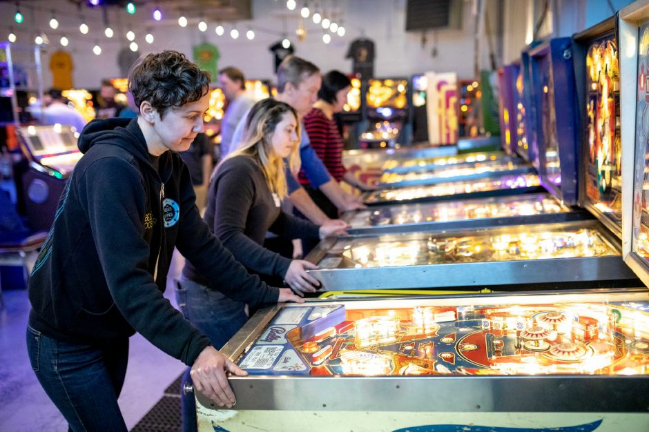 Emily May, of Hamden, plays pinball at The Sanctum in Meriden Sunday.