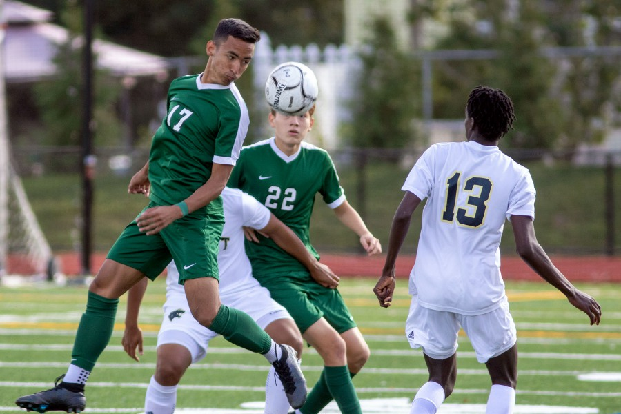 Maloney's Alex Torres moves the ball downfield against Platt during Saturday's rivalry game at Maloney High School. Torres scored the winning goal with 8:31 to play in the Spartans' 2-1 victory. Aaron Flaum, Record-Journal