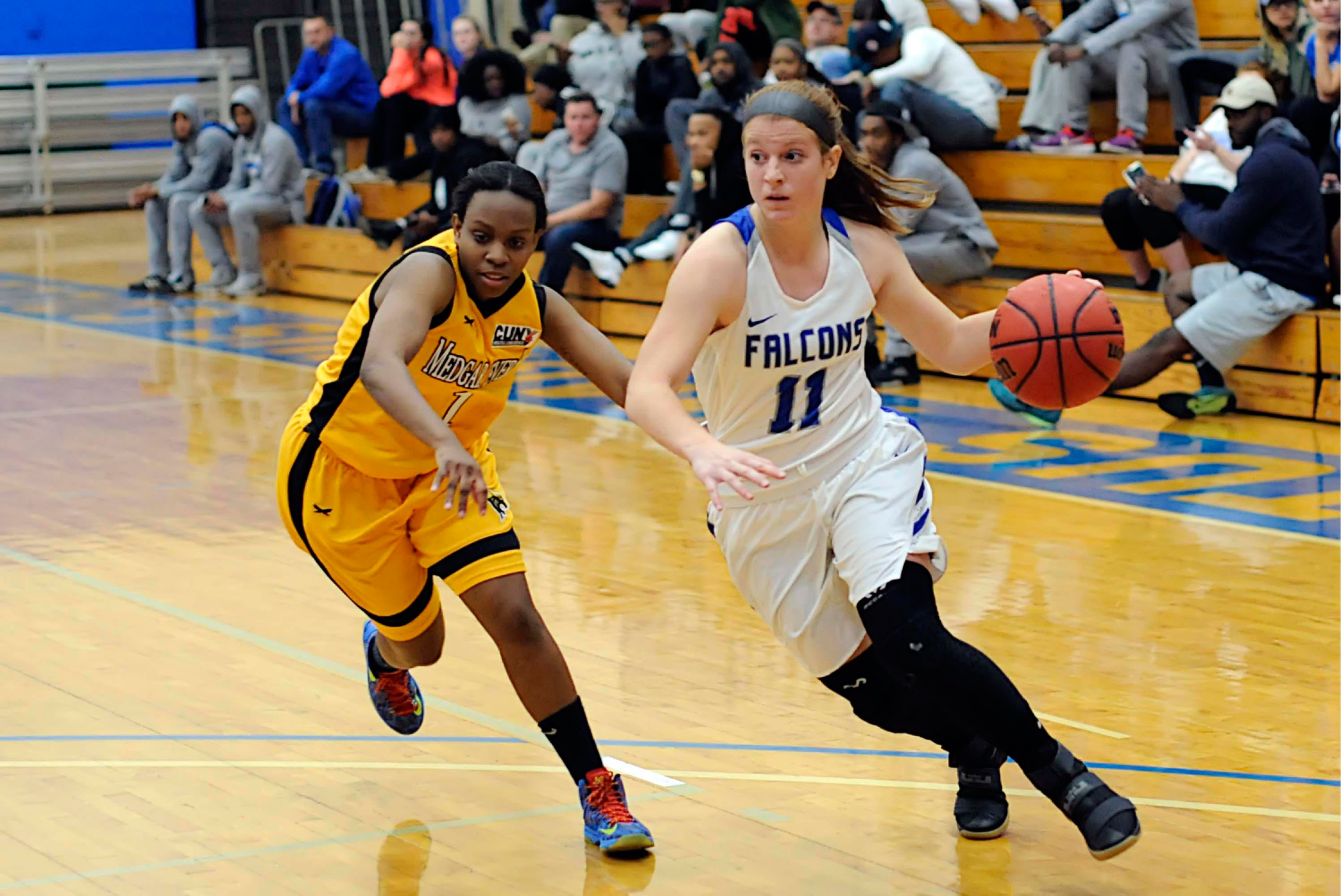 Liz Falcigno drives past a defender in a recent game against Medgar Evers. Falcigno, of Wallingford, had 21 points, 10 rebounds and seven assists in Albertus Magnus' record-setting 117-91 win over Pine Manor on Tuesday night. | Ron Waite, Photosportacular