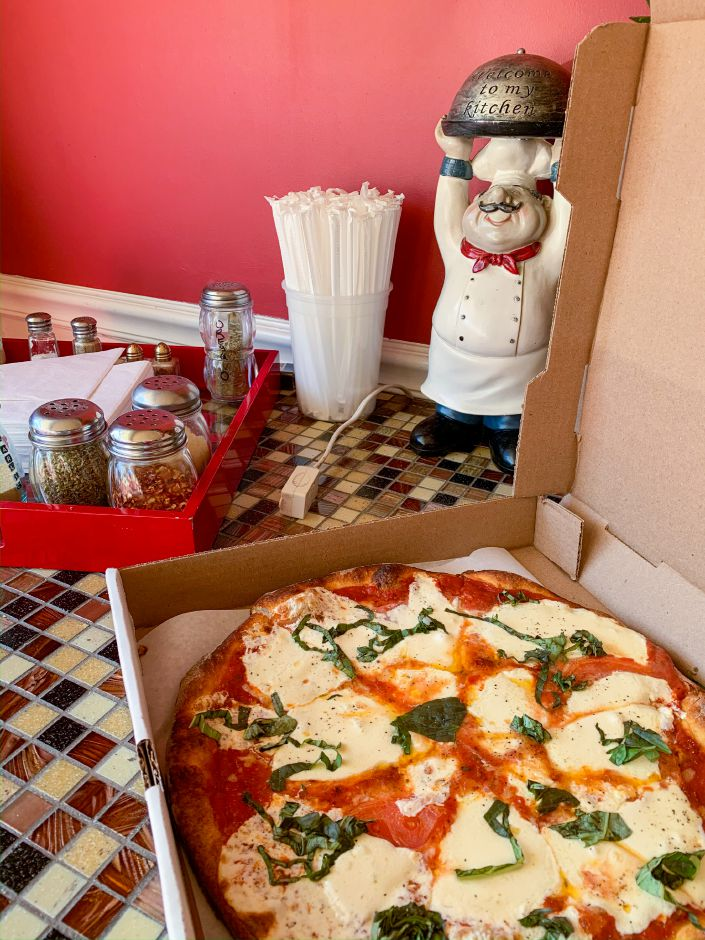 Andrea's Pizza offers delicious and inexpensive Italian cuisine. This margarita pizza is a red pie with basil, tomatoes, garlic, olive oil and fresh mozzarella. |Lindsay Pytel, special to Record-Journal