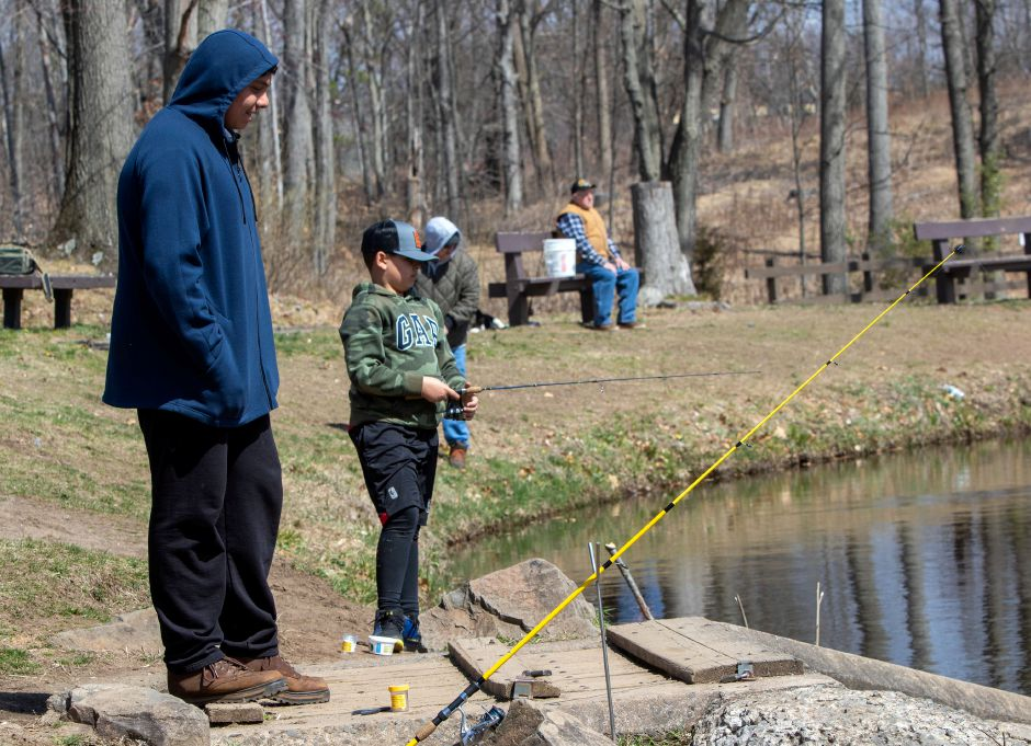 Paul Bernardo 17 of North Haven looks on as Luca Palmieri 9 of Wallingford reels in his line at Wharton Brook State Park in Wallingford on Wednesday, April 1, 2020. Aaron Flaum, Record-Journal