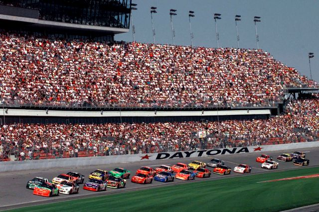 "FILE - In this Feb. 11, 1999, file photo, drivers in the first 125-mile Daytona 500 qualifying race start the race at Daytona International Speedway in Daytona Beach, Fla. Daytona Beach became the unofficial ""Birthplace of Speed"" in 1903 when two men argued over who had the fastest horseless carriage and decided things in a race on the white, hard packed sand along the Atlantic Ocean.(AP Photo/Chris O"