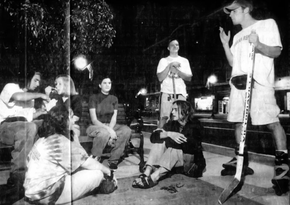 Wallingford teens enjoy late-night snacks, smokes and conversation on Simpson Court Sept. 2, 1994.